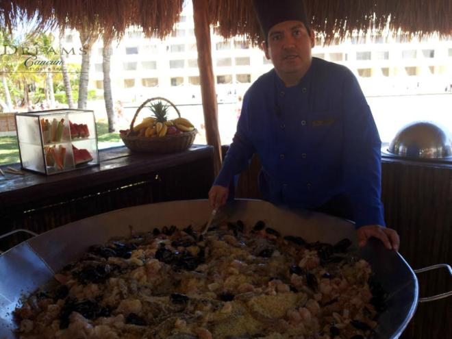 Executive at Dreams Cancun Resort & Spa, Chef Mario Hernandez cooking a deliciuos Paella.