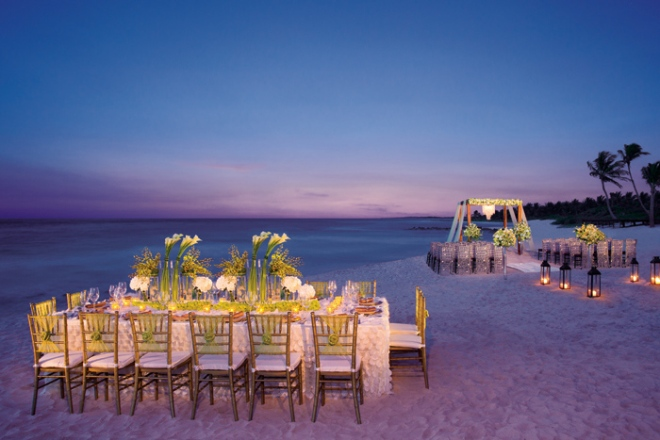 A beautiful wedding reception set-up on the beach at Dreams Tulum