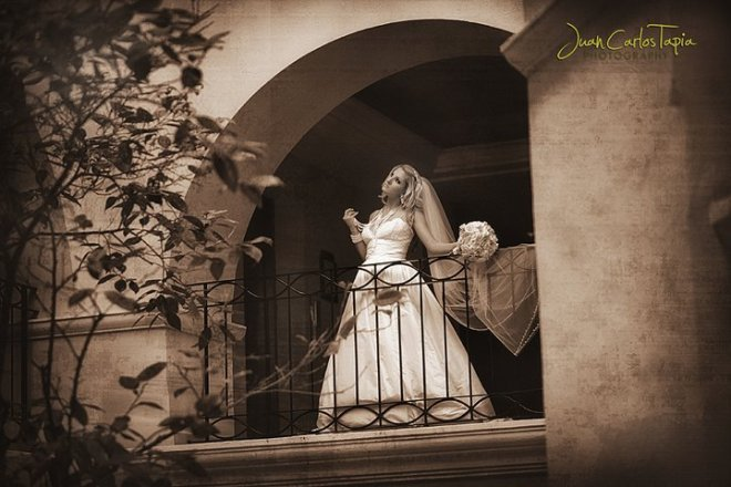 Newlywed Jasmine looks wistfully into the distance from her balcony at Dreams Los Cabos Resort & Spa.