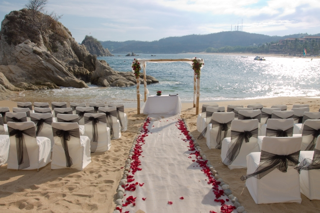 Walk down the aisle with gorgeous rock formations surrounding you in the sparkling waters of the Pacific.