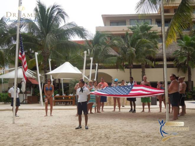 Guests join in the flag ceremony at Dreams Puerto Aventuras Resort & Spa.