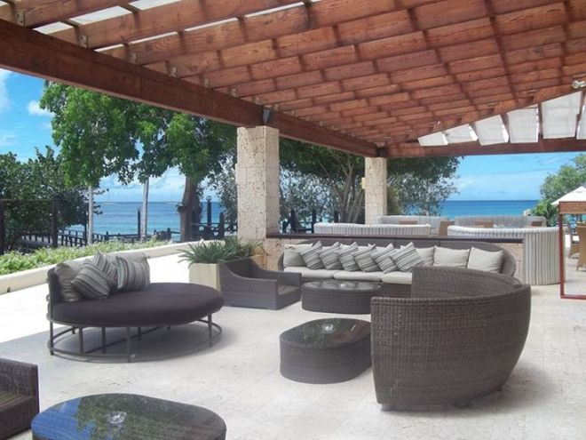 Sip on a cool drink under the shade of one of our lounge areas at Dreams La Romana Resort & Spa.