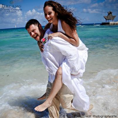These newlyweds are having a blast frolicking in the crystal blue waters of the Caribbean at Dreams Puerto Aventuras Resort & Spa.