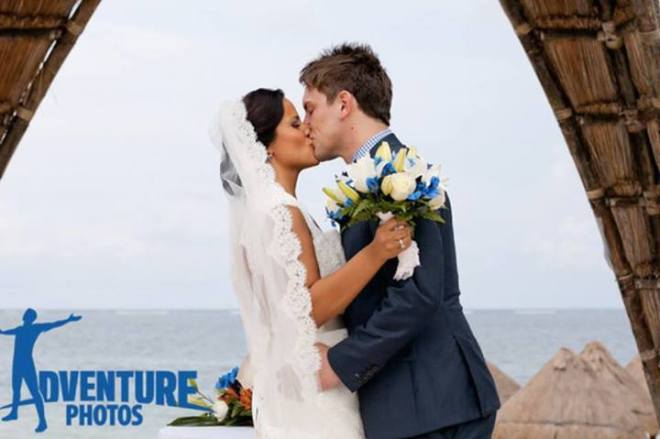 """Sandra smooches her new husband after the """"I do's"""" at Dreams Riviera Cancun."""