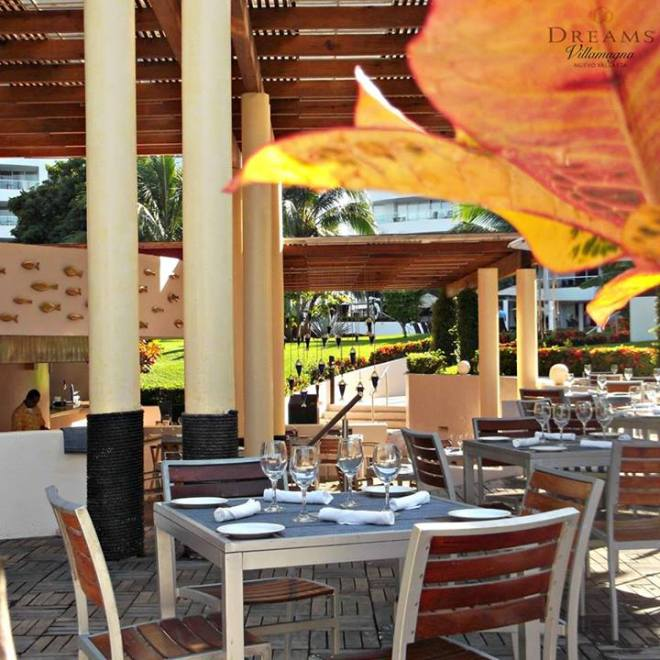 The cafe tables are all set and ready for guests to arrive at Dreams Villamagna Nuevo Vallarta