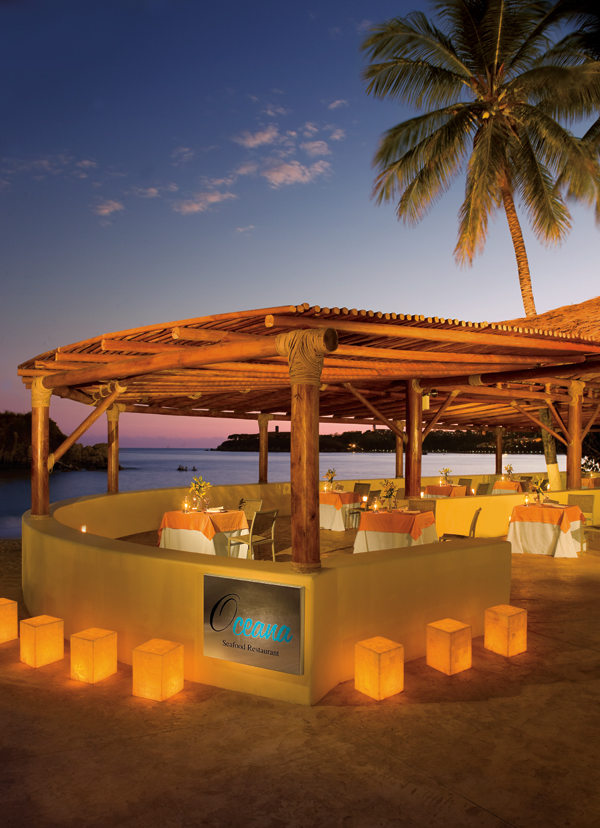 Oceana offers fresh seafood under a giant palapa overlooking the ocean.