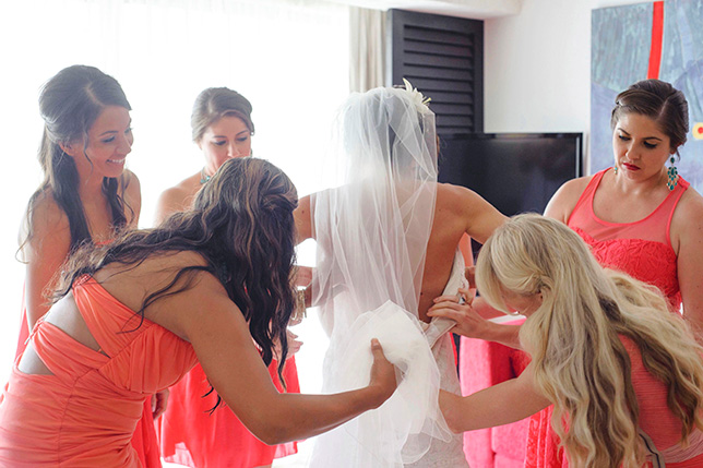 Heather's bridesmaids help her prepare to walk down the aisle!