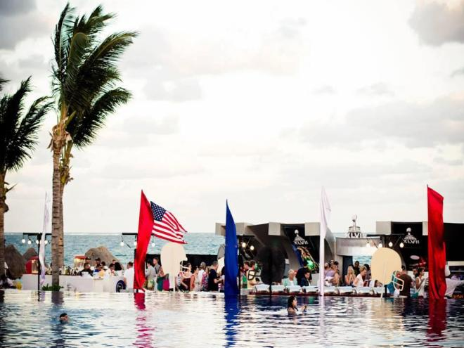 Party by the infinity pool at Dreams Riviera Cancun Resort & Spa