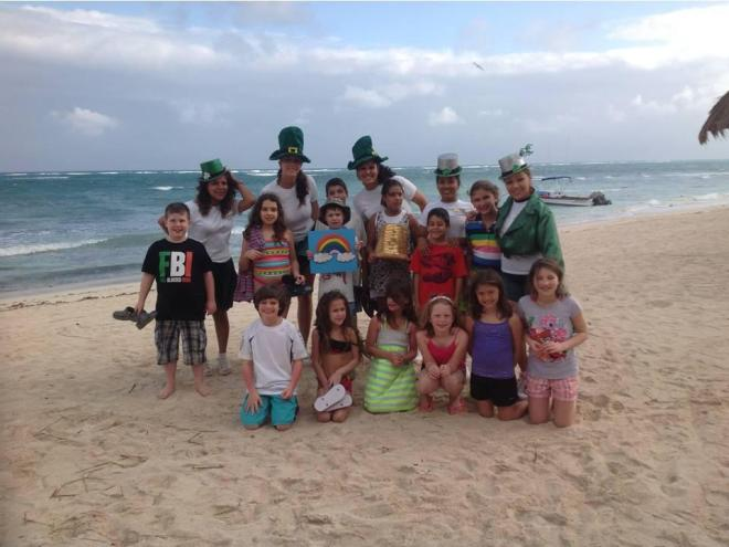 Kids enjoying St. Patrick's Day-themed activities at the Explorer's Club, at Dreams Tulum Resort & Spa!