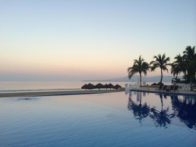 We love the reflection of that pastel sky on the water. Thanks to Stacy C. for this shot of Dreams Villamagna Resort & Spa!