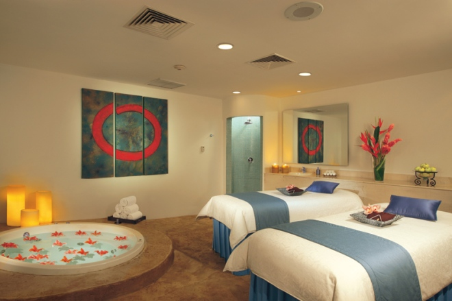 A couples massage suite at the Dreams Spa by Pevonia.