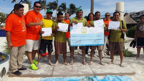 Dreams Riviera Cancun staff compete, collecting almost 50,000 pounds of sargassum from the beach!