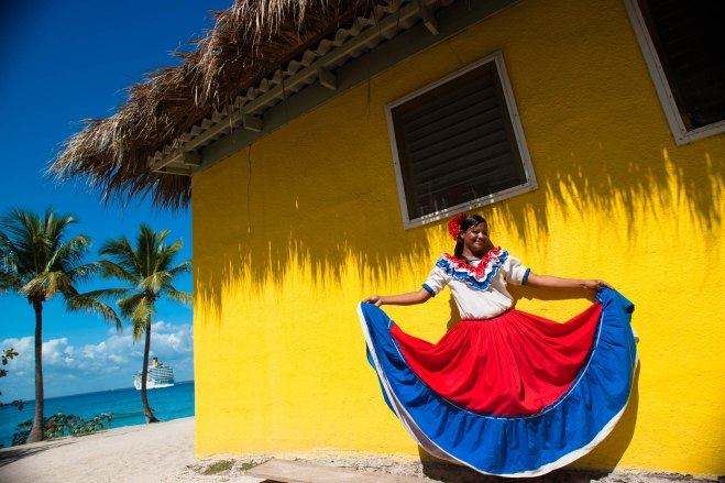 Catalina Island, Dominican Republic. A woman in traditional outf
