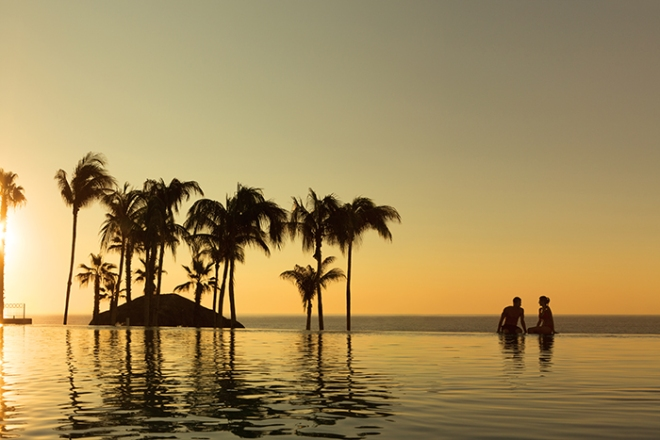 DRELC_EXT_Couple_InfinityPool_Sunset_1A.jpg